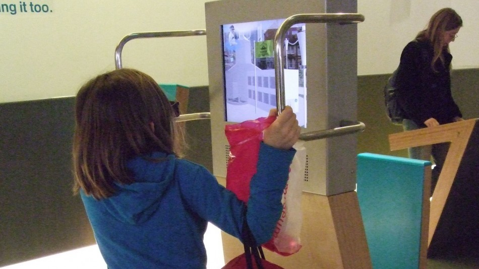 A child using the interactive exhibit at The Science Museum