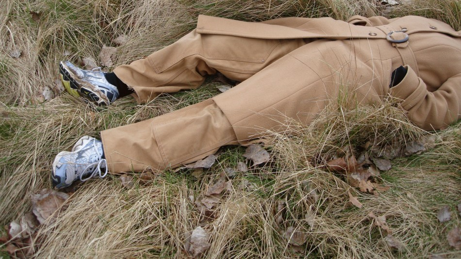 A woman lying in the grass