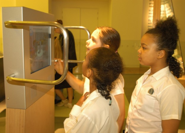 Children using the interactive exhibit at The Science Museum