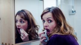 Karen looking in mirror