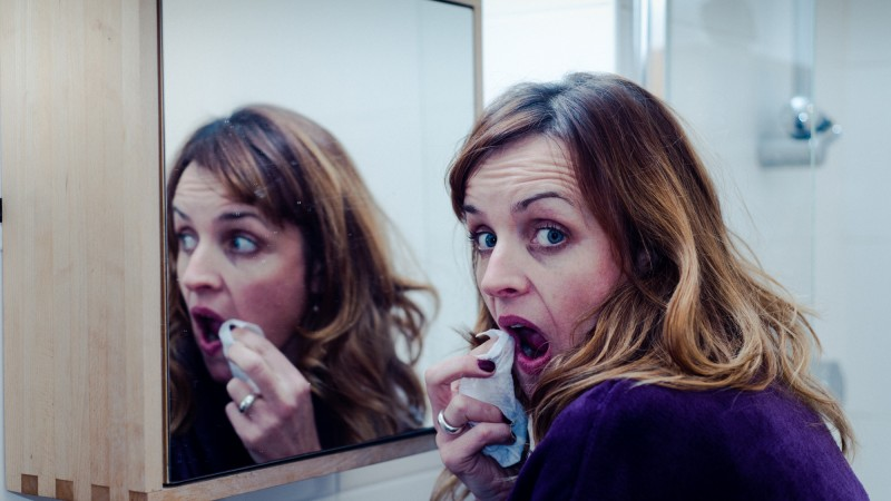 Karen looking in mirror
