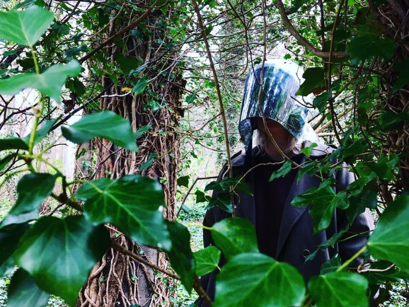 Violeta Marchenkova trials a prototype mirrored helmet in the woods.